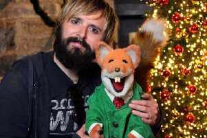 Music video producer Chris Clark with legendary TV joker Basil Brush. EMN-181127-112630001