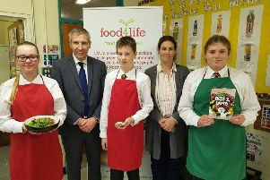 Ian Stevenson, LMC Chief Executive, pictured with Mrs Lisa Donnan, Home Economics teacher and pupils from Friends' School, Lisburn during the launch of LMC's post-primary school cookery demonstrations