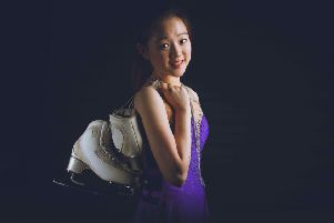 Rachel Yu in her costume and skates ready to take on the competition