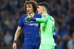 Kepa Arrizabalaga reacts with David Luiz of Chelsea as he refuses to be substituted during the Carabao Cup Final between Chelsea and Manchester City at Wembley Stadium (Photo by Clive Rose/Getty Images)