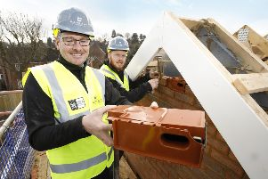 Swift Bricks are being installed in new homes in a Barratt development in Hassocks. Pictured is bricklayer apprentice Sam Hoppe and site manager Toby Carson SUS-190227-165549001