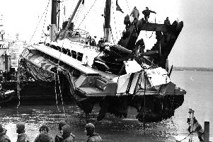 Watched by Royal Navy divers the battered SRN-6 hovercraft is raised from the Portsmouth seabed in England. March 8, 1972.(Photo by Express/Hulton Archive/Getty Images)