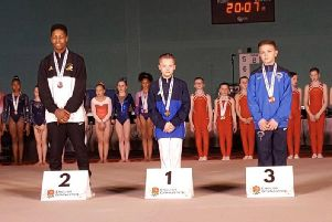 Under 14s vault champion Luke Marsh on the winner's podium