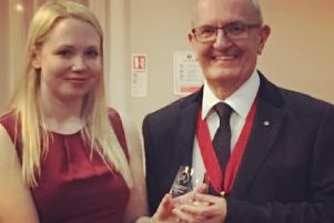 Rally driver Ashleigh Morris receiving one of her trophies at the Association of North Western Car Clubs 2018 awards