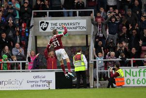 Matt Taylor celebrates one of his several free-kicks scored for the Cobblers