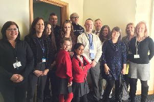Children (past and present), staff and guests at the sensory room opening