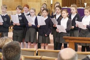 The group of students who joined the church choir