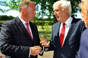 Garry Wall (left), leader of Mid Sussex District Council, pictured last year talking to Homes England chairman Sir Edward Lister
