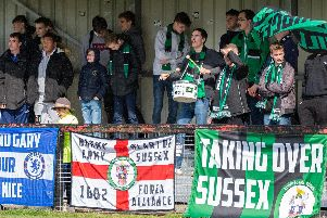 Burgess Hill Town fans cheer their team on