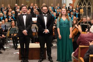 Soloists (L to R) Meilir Jones (bass), Peter Harris (tenor) and Catriona Holsgrove (soprano), pictured with Burgess Hill Choral Society, 27 April 2019. Photo copyright  Laurence Leng