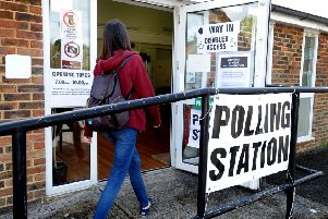 A voter attends a Burgess Hill polling station