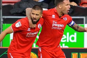 Crawley Town's Jimmy Smith, right, celebrates scoring a goal at the start of the season.'Picture by Steve Robards.