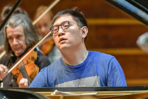 Picture by Andrew Mardell: Yi-Yang Chen in rehearsal with WSO.