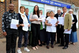 Upset residents and councillors outside Boots Pharmacy in America Lane, Haywards Heath. Photo by Steve Robards