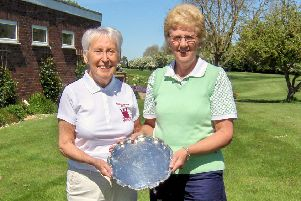 Pictured is Lady Captain Pam Clare handing over the trophy to Chris Sherriff.