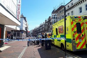 Emergency services on scene outside TJ Hughes in Seaside Road, Eastbourne town centre SUS-190523-121139001
