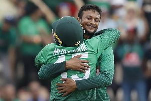 Bangladesh's Shakib Al Hasan, right, celebrates with team-mate Mushfiqur Rahim after the dismissal of Afghanistan's Najibullah Zadran  Picture: ADRIAN DENNIS/AFP/Getty Images