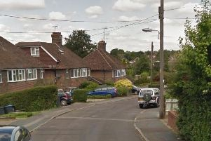 Three police cars were seen parked in Edward Road in Haywards Heath. Picture: Google Street View