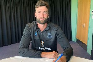 Reece Topley signs for Sussex. Picture courtesy of Sussex Cricket