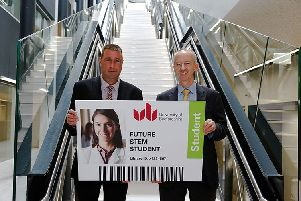 Douglas Stephen, project manager for R G Carter hands over the 'key card' to Donald Harley, deputy vice-chancellor of the University of Bedfordshire