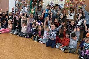 Pupils at a previous Carla Lucas holiday camp with their hands in the air