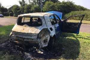 The burnt-out Renault Megane was torched and dumped in a Northampton neighbourhood.