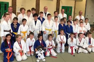 A group shot of the judo aces.