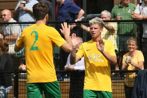 Chris Smith (right) celebrates opening the scoring in Horshams historic 3-1 home win over Crawley Town on Saturday. Photo by Derek Martin Photography