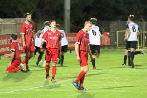 Hassocks heads drop as Pagham celebrate the winner. Picture by Roger Smith