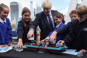 Boris Johnson is given a lesson in Lego by pupils from Gomer Junior School and Bay House School during a maritime event in London. Photo: Downing Street