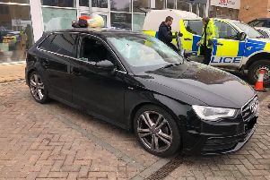 Police smashed Walter's car windows before detaining him