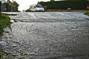 The burst caused flooding in the area. Photo by Eddie Howland