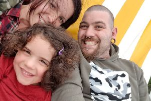 Elexia and her parents, who are raising funds for the garden