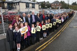 Alderman Allan Ewart MBE, Chairman of the Local Action Group and the council's Development Committee and Alderman Jim Dillon MBE, Vice-Chair of Development Committee visit Andrew Armstrong, Principal of Dromara Primary School and his pupils to see what they think of the extended pedestrian footpath