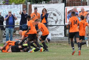 Tendai Daire of Lutterworth Town is mobbed by his team mates after scoring the winning goal. Pictures by Andrew Carpenter