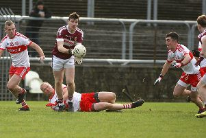 Banagher's Brian Og McGilligan gives a pass out to Tiernan Moore against Glenfin during the Ulster Intermediate Club Championship in MacCumhaill Park, Ballybofey. (Picture: Thomas Gallagher)