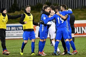 Dungannon players celebrate after winning on penalties against Cliftonville