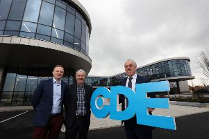 """Pictured marking the hand-over of the development are Tony Convery, right, Chairman of CDE  Jason Arthur left, from architects and engineers Teague and Sally, and Liam Murphy, cemtre, from building contractor Felix O�""""Hare. CDE will now put in place the finishing touches to the impressive facility, including erecting signage, before beginning to move equipment and staff into the building in the months ahead."""