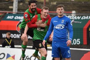 Glentoran's Stephen Gordon opens the scoring against Dungannon Swifts