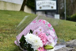 Flowers  at the scene  as Three teenagers have died after reports of a crush at a St Patrick's Day party at a hotel in Cookstown, County Tyrone.' A 17-year-old girl and two boys aged 16 and 17 died after the incident outside the Greenvale Hotel on Sunday night.' A number of other teenagers have also been treated in hospital. 'Photo: Colm Lenaghan/Pacemaker