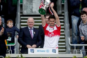 Derry captain Christopher McKaigue lifts the Division Four trophy after their victory over Leitrim in Croke Park.