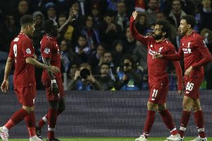 Liverpool's Mohamed Salah, second right, celebrates after scoring his side's second goal