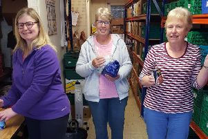 Stephanie Tyndall and Doreen Crymble from Carnmoney Church at work in the warehouse with  (centre) Norma McIlveen from Abbey Presbyterian.