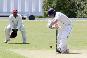 Finchampstead batsman Mac Keast faces a delivery as Banbury wicket keeper Shazad Rana looks on. Photo: Steve Prouse