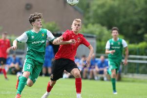 JD Club NI graduate Ross McCausland (in red) has signed a three-year professional deal with Rangers.
