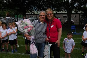 Teaching assistant Caroline Holmes is thanked by headteacher Sally Howley for her 30 years of dedication to Brown's School, Horbling. EMN-190207-110454001
