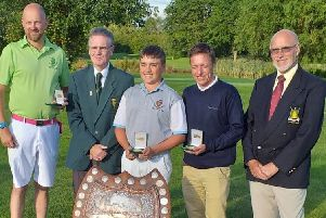 The winning Sleaford team, Dan Withers (left), Michael Baines (centre), and Dillon Ormesher (second right) with the sizeable Lunn Shield EMN-190718-124405002