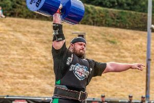 Chris McNaghten putting his strength to the test in a previous competition.