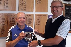 From left, Tom Wood receives The Past Captains' Summer Cup from Little Hay Golf Club's club captain Paul Mudd.