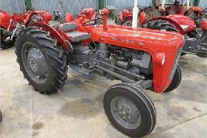 Pictured is a model of tractor stolen not the actual tractor.